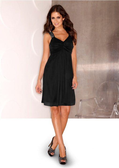 Koktajlowa czarna sukienka z błyszczącymi ramiączkami