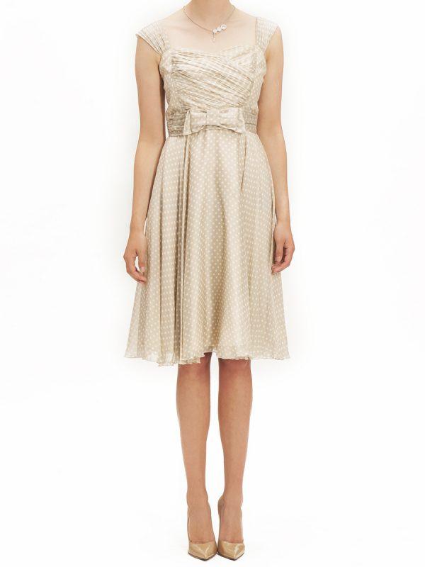 Beżowa sukienka w groszki z kokardką