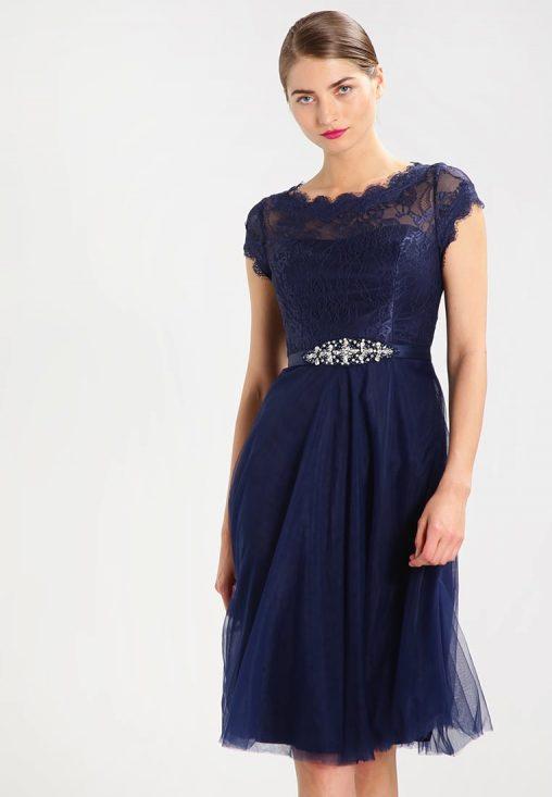 Koktajlowa granatowa sukienka z wycięciem na plecach