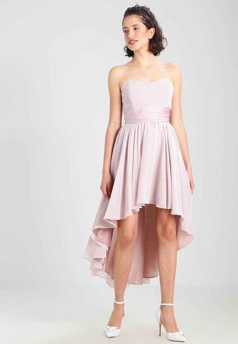 Koktajlowa gorsetowa sukienka dłuższy tył różowa
