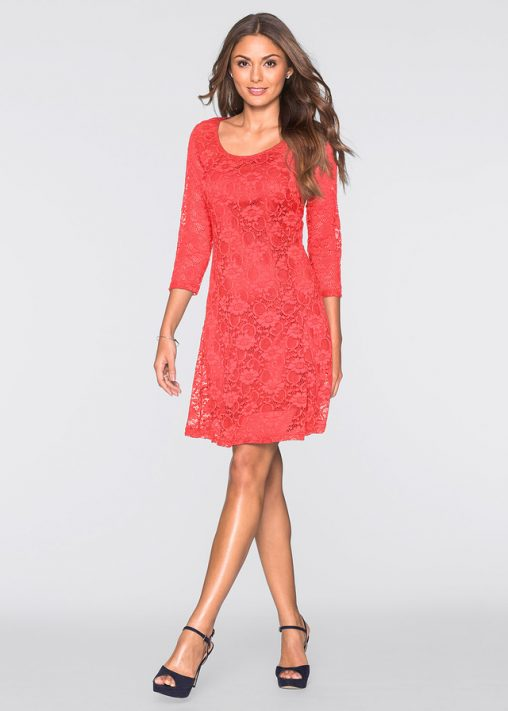Koronkowa koralowa sukienka rozkloszowana