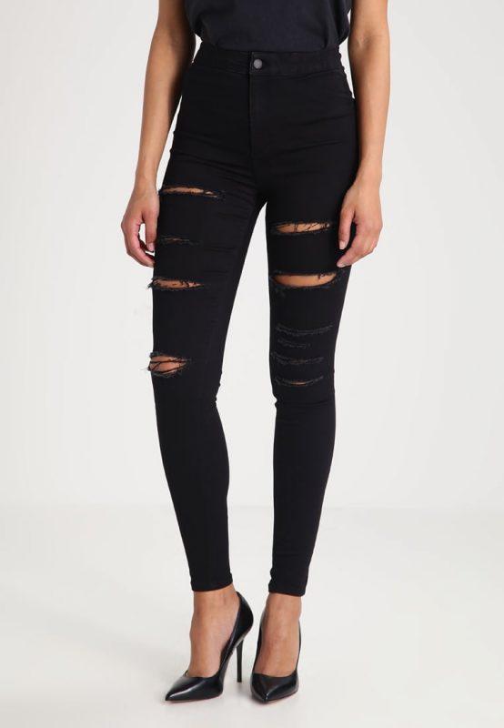 Czarne jeansy damskie z dziurami