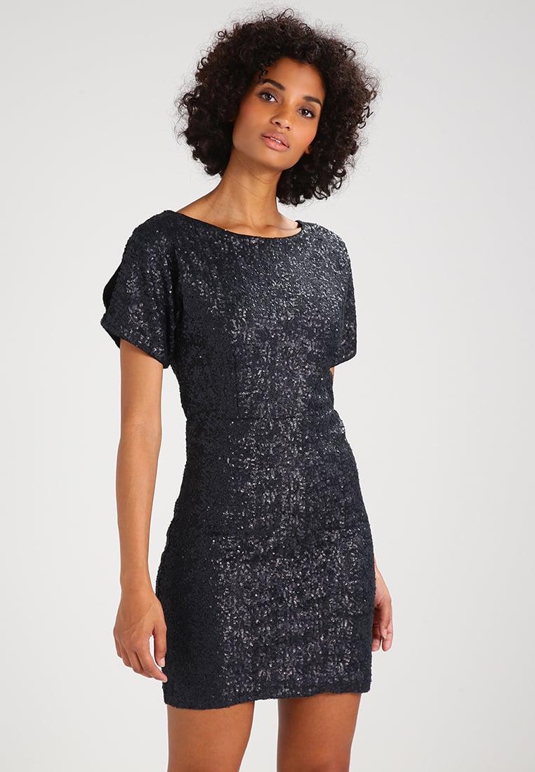 Sylwestrowa połyskująca sukienka z wycięciem na plecach