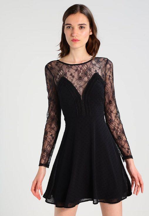 Modna sukienka z rękawami z koronki czarna. Idealna na wesele lub sylwestra